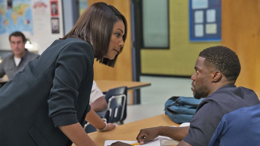 """This image released by Universal Pictures shows Tiffany Haddish, left, and Kevin Hart in a scene from """"Night School,"""" in theaters nationwide on Sept. 28."""