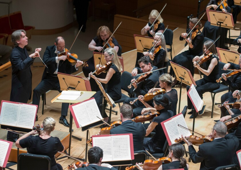 Esa-Pekka Salonen conducts the Philharmonia Orchestra on Tuesday night at Costa Mesa's Renee and Henry Segerstrom Concert Hall.