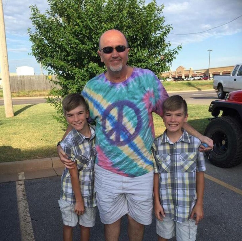 """(Center) Jerry Greenough with his grandson (L-R) Austyn and Tyler Kerley. Gerard """"Jerry"""" Greenough, 63, saved his 13-year-old grandson, Austyn Kerley life by using his body to cushion the fall after their jeep tumbled 150 feet off a cliff in New Mexico."""