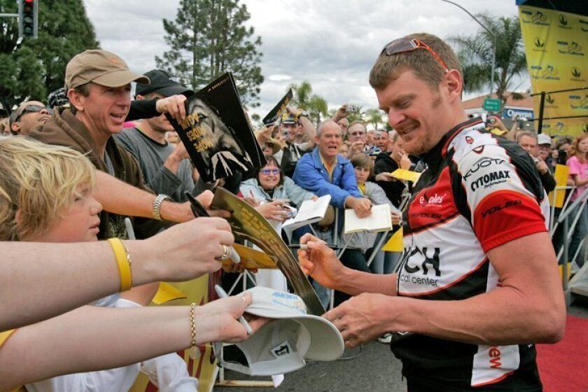Floyd Landis signs autographs in Rancho Bernardo before the final stage of the Amgen Tour of California bike race in late February 2009.