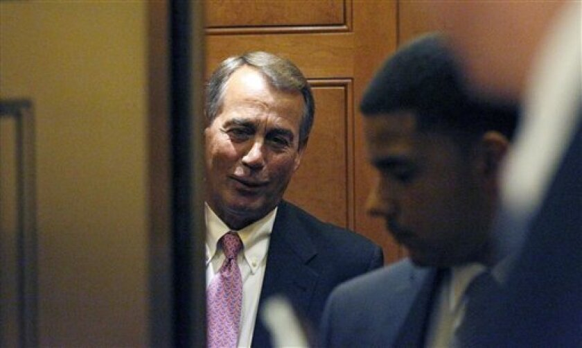 Speaker John Boehner of Ohio, stands as the elevator door closes on Capitol Hill as Congress continues to debate in hope of avoiding a government shutdown Friday, April 8, 2011 in Washington.(AP Photo/Alex Brandon)