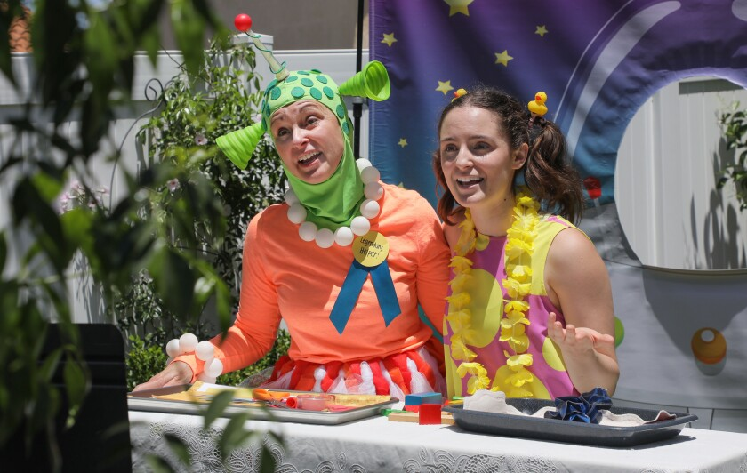 """On Sunday, May 24, Ruth Weber, left, and her daughter Emilia Lopez-Yañez performed their live weekly children's show """"Sunday Funday"""" in Weber's backyard. The show airs on Facebook Live."""