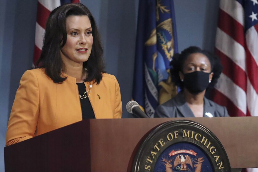 FILE - In this Aug. 19, 2020, file photo, provided by the Michigan Office of the Governor, Michigan Gov. Gretchen Whitmer addresses the state during a speech in Lansing, Mich. Court majorities are at stake beyond Washington, D.C., as voters chose justices for state supreme courts that have been thrust into politicized clashes over voter access and the emergency powers of governors fighting the coronavirus outbreak. Michigan Gov. Gretchen Whitmer, a Democrat, wants to flip control of the state's Republican-majority high court .(Michigan Office of the Governor via AP, File)