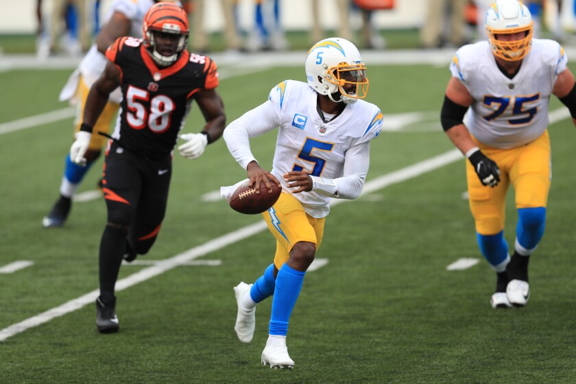 Chargers quarterback Tyrod Taylor scrambles during the first half against the Cincinnati Bengals.