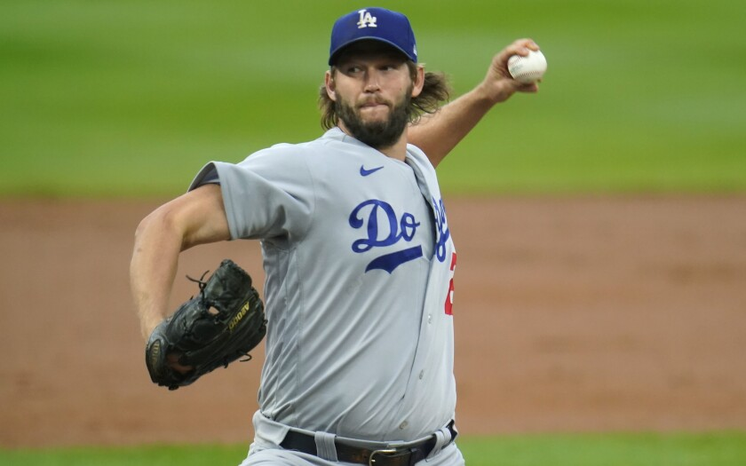 Dodgers starting pitcher Clayton Kershaw delivers against the Colorado Rockies.