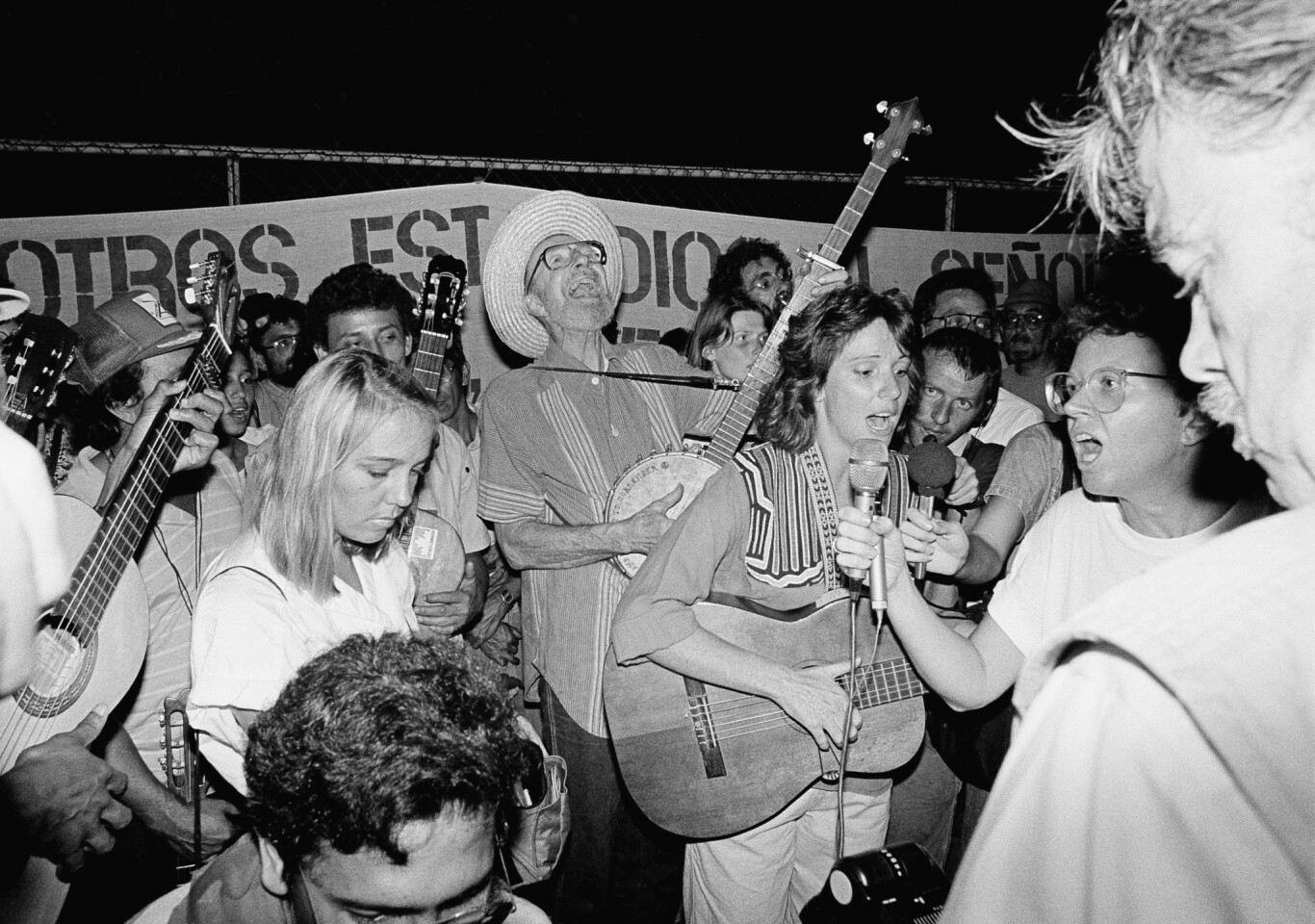 Seeger joins in a song at a 1988 rally outside the U.S. Embassy in Managua, Nicaragua. The gathering was to protest U.S. aid going to the Nicaraguan Contra rebels.