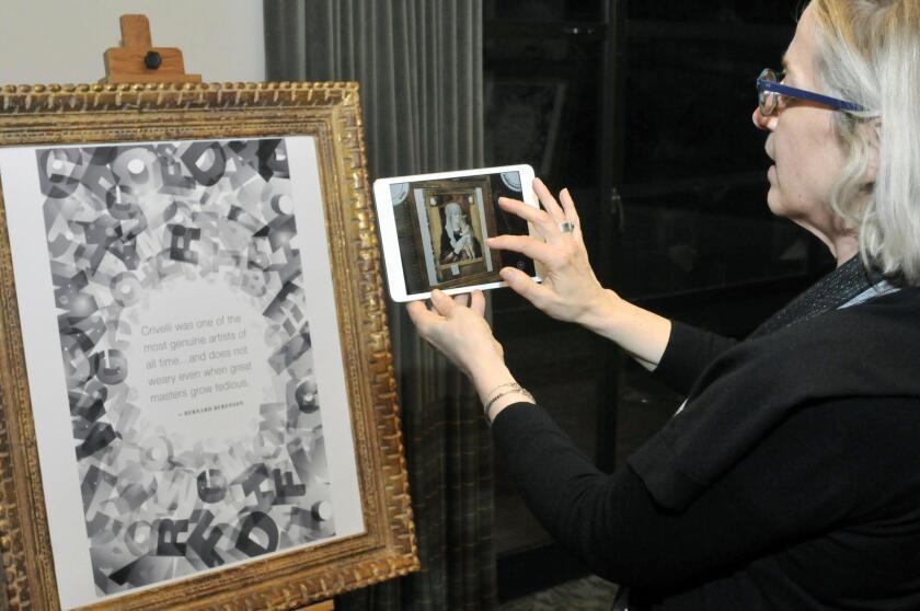 The Guru global partnership director Marcia Finkelstein demonstrates how to view the virtual art