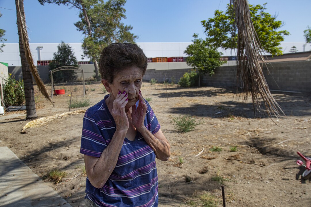 Warehouses squeeze out residents in Fontana.