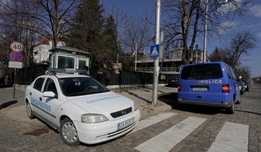 In this Friday, Feb. 26, 2016 frame made from AP video, Police cars are parked outside the Palestinian Authority's embassy in Sofia, Bulgaria. Bulgarian authorities are investigating the unexplained death on Friday of a Palestinian man wanted by Israel for a 1986 killing. His death at the Palestinian Authority's embassy in Sofia was described by the ambassador as murder. (AP Photo)