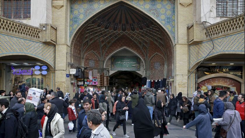 In this Thursday, Feb. 7, 2019, photo, people walk around the Grand Bazaar in Tehran, Iran. The eco