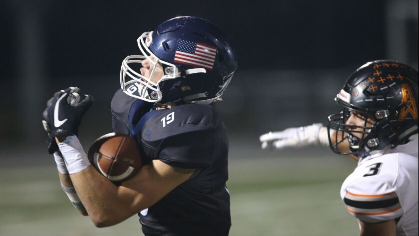 Newport Harbor receiver Aiden Goltz makes a difficult catch during Sunset League football game again