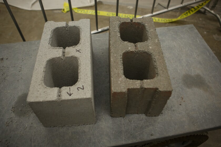 Two concrete bricks made with recycled carbon dioxide.