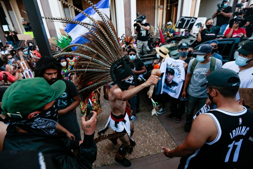 Aztec dancers join others at rgw rally for Andres Guardado.