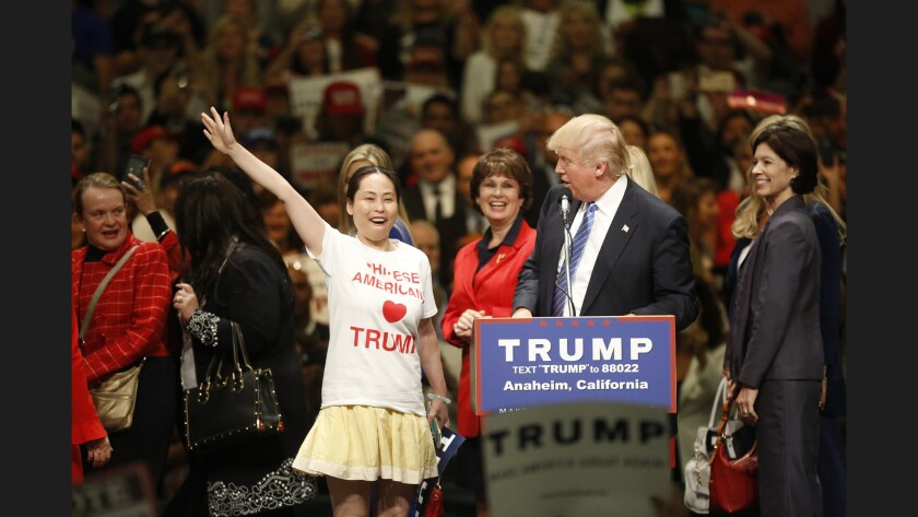 A woman shows her support for President Trump at a recent rally in Anaheim.