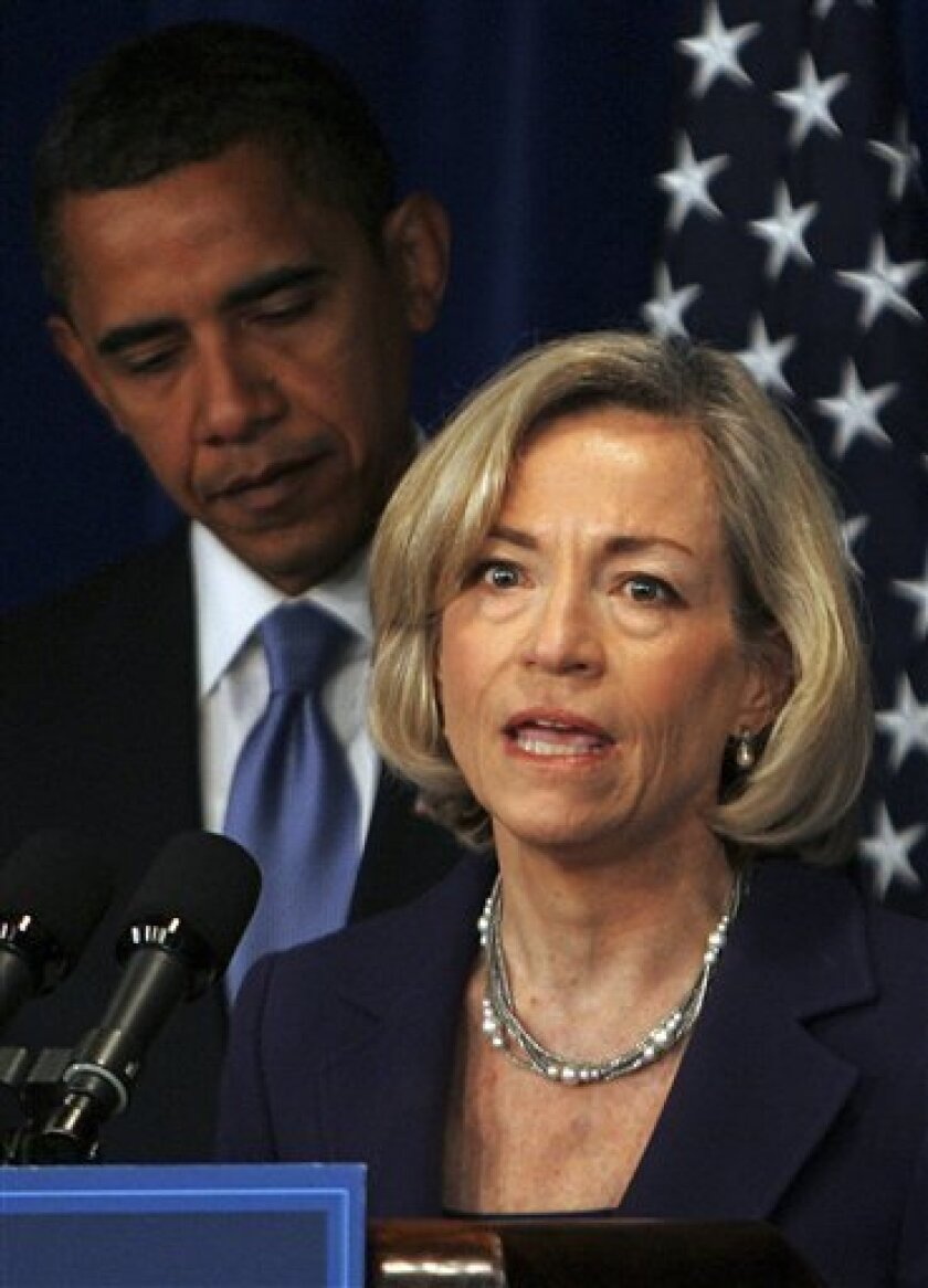Nancy Killefer makes a few remarks after President-elect Barack Obama, left, introduced her to the newly created position of chief performance officer, Wednesday, Jan. 7, 2009, at his transition office  Washington. (AP Photo/Lawrence Jackson)