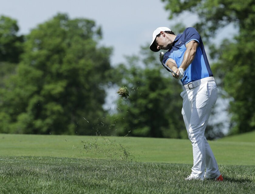 Rory McIlroy, of Northern Ireland, hits on the ninth hole during the second round of the Memorial golf tournament, Friday, June 3, 2016, in Dublin, Ohio. (AP Photo/Darron Cummings)