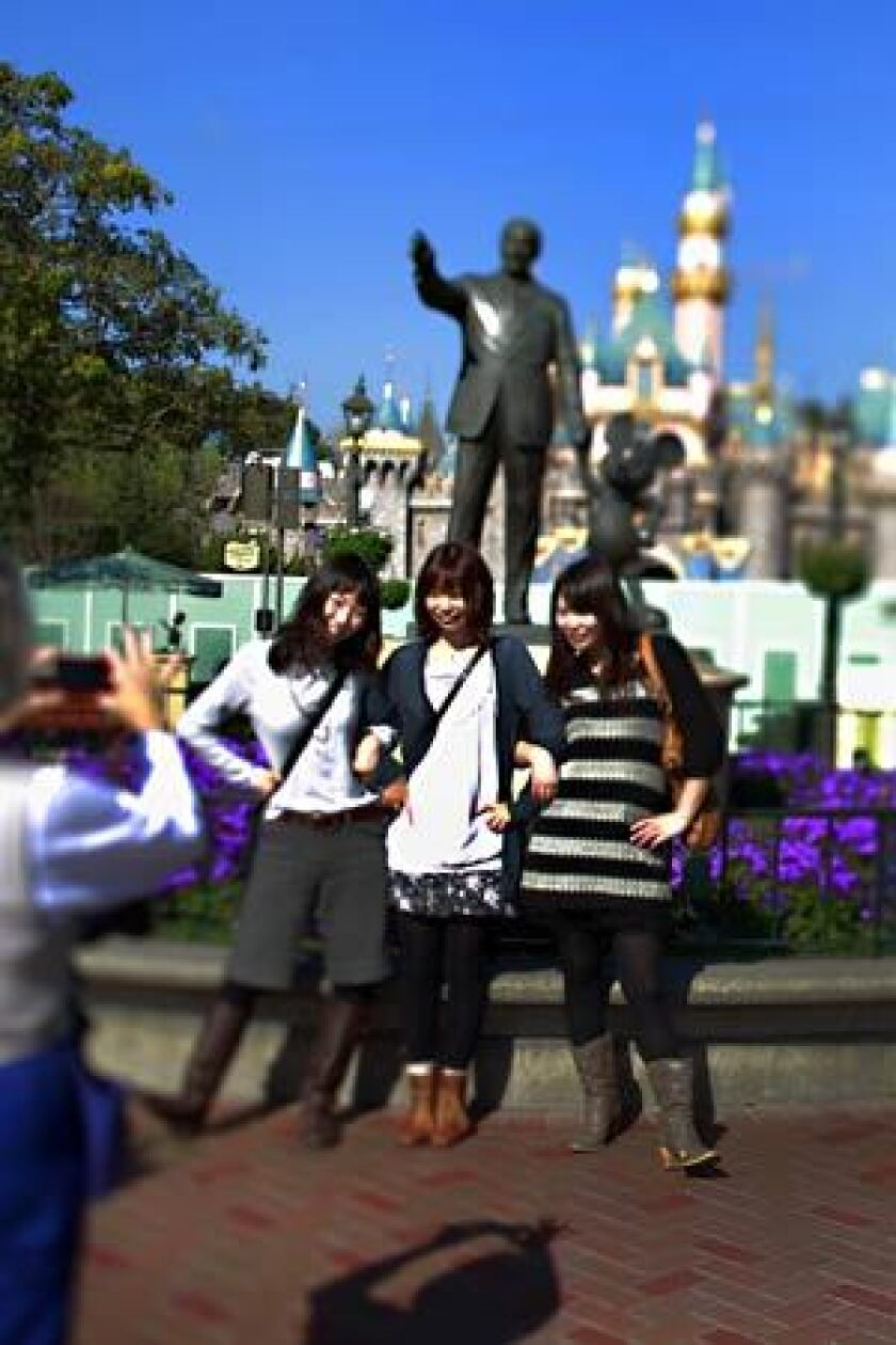 Japanese tourists take a photo at Disneyland. California was the third-most popular destination in the U.S. for international travelers last year