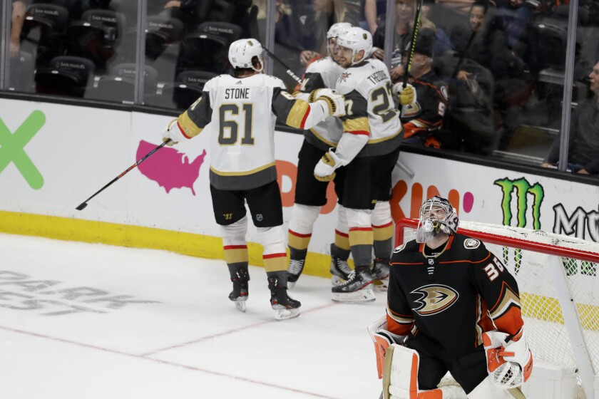 Ducks goaltender John Gibson reacts after giving up the winning goal to Vegas Golden Knights defenseman Shea Theodore in overtime of a 6-5 loss Sunday.