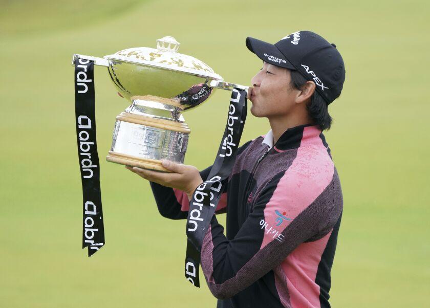 Australia's Min Woo Lee holds the trophy after winning the Scottish Open at The Renaissance Club, North Berwick, Scotland, Sunday July 11, 2021. (Jane Barlow/PA via AP)