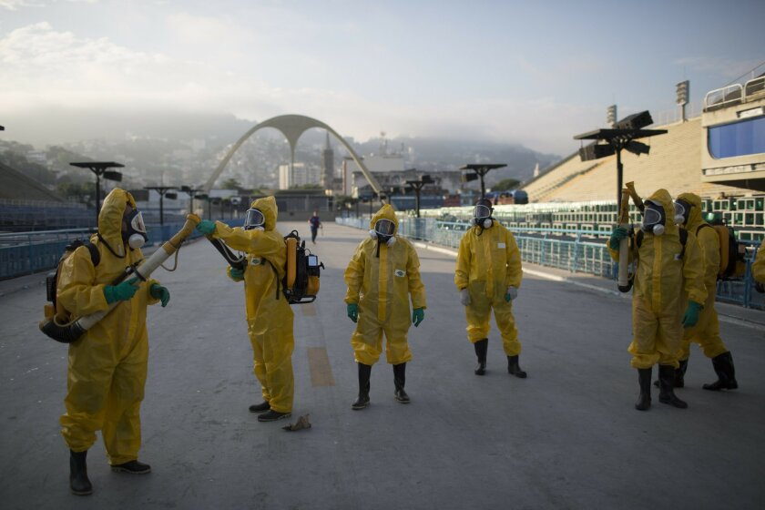 FILE - This is a  Tuesday, Jan. 26, 2016  file photo of health workers as they get ready to spray insecticide to combat the Aedes aegypti mosquitoes that transmits the Zika virus under the bleachers of the Sambadrome in Rio de Janeiro,  which will be used for the Archery competition in the 2016 sum