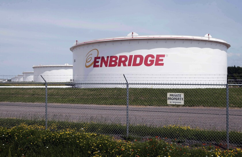 """FILE - This June 29, 2018 file photo shows tanks at the Enbridge Energy terminal in Superior, Wis. The state of Minnesota has gone to federal court to block a lawsuit over Enbridge Energy's Line 3 oil pipeline project from proceeding in tribal court. The novel case names Manoomin — the Ojibwe word for wild rice — as the lead plaintiff. Wild rice is sacred in Ojibwe culture and a traditional source of food. The lawsuit, which was filed two weeks ago in the White Earth Band's tribal court, is the first """"rights of nature"""" enforcement case brought in a U.S. tribal court and the second such case to be filed in any U.S. court. (AP Photo/Jim Mone, File)"""