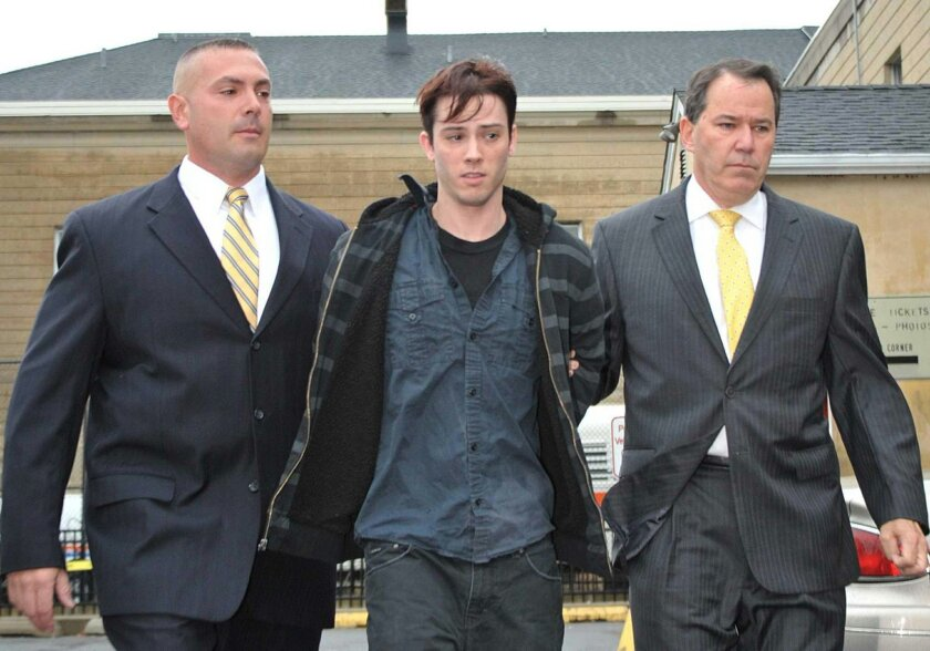 FILE - In this Oct. 19, 2012, file photo, James Ryan, of Oakdale, N.Y., is escorted from Nassau County Police headquarters, in Mineola, N.Y., after his arrest on drunken driving charges. Ryan was found guilty Thursday, Feb. 11, 2016, of vehicular manslaughter and other charges in the death of a pol