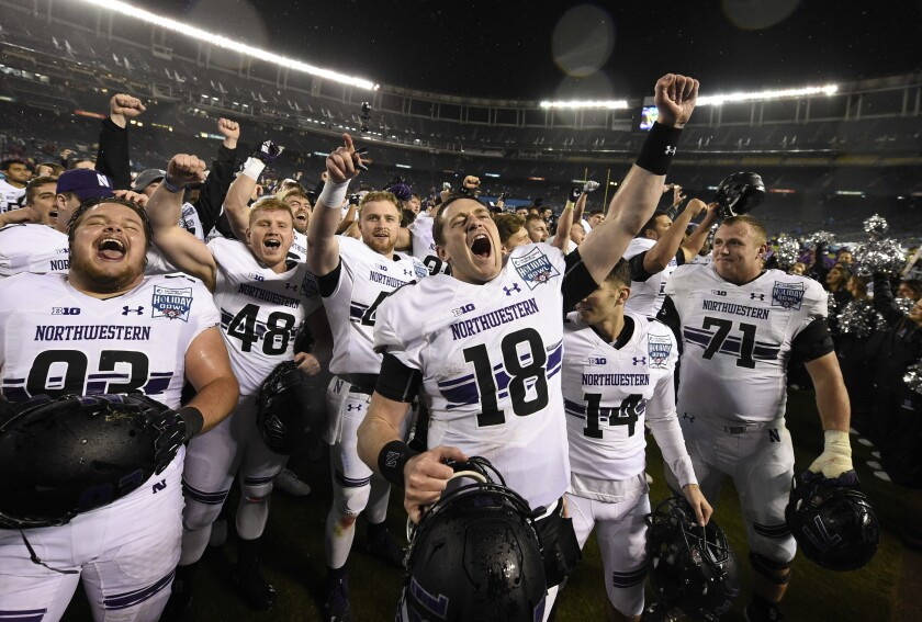 Northwestern quarterback Clayton Thorson (18) and his teammates celebrate after defeating Utah in the 2018 SDCCU Holiday Bowl on New Year's Eve at SDCCU Stadium.