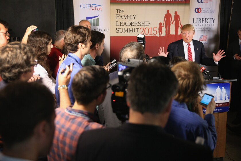 Republican presidential hopeful Donald Trump fields questions from the media at the Family Leadership Summit at Stephens Auditorium in Ames, Iowa.