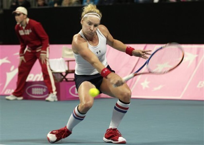 American Bethanie Mattek-Sands returns the ball towards Belgium's Yanina Wickmayer during the World Group Fed Cup match in Antwerp, Belgium, Saturday, Feb. 5, 2011. (AP Photo/Yves Logghe)