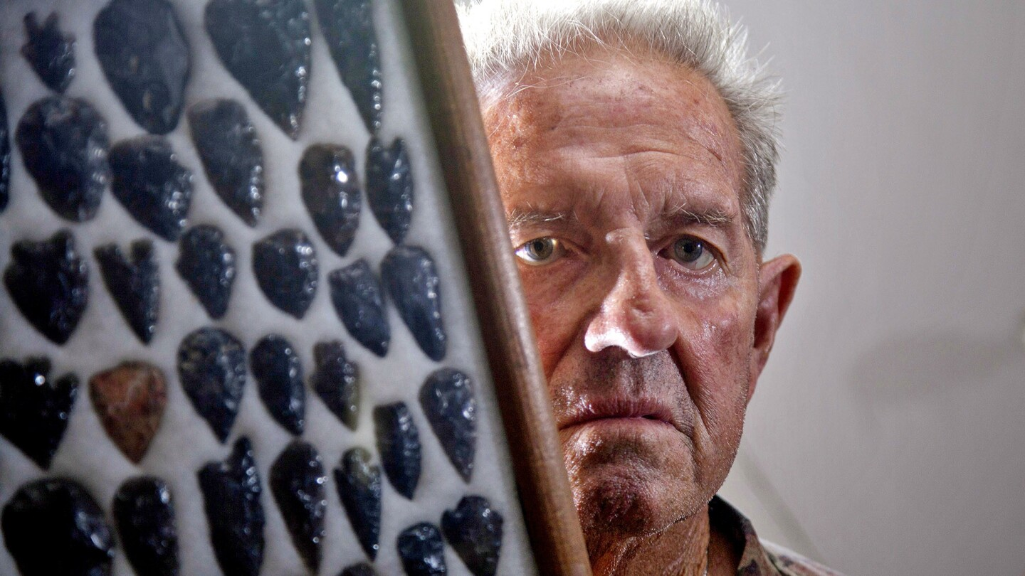 Lone Pine resident Norman Starks, 76, with a framed collection of arrowheads at his Lone Pine home.