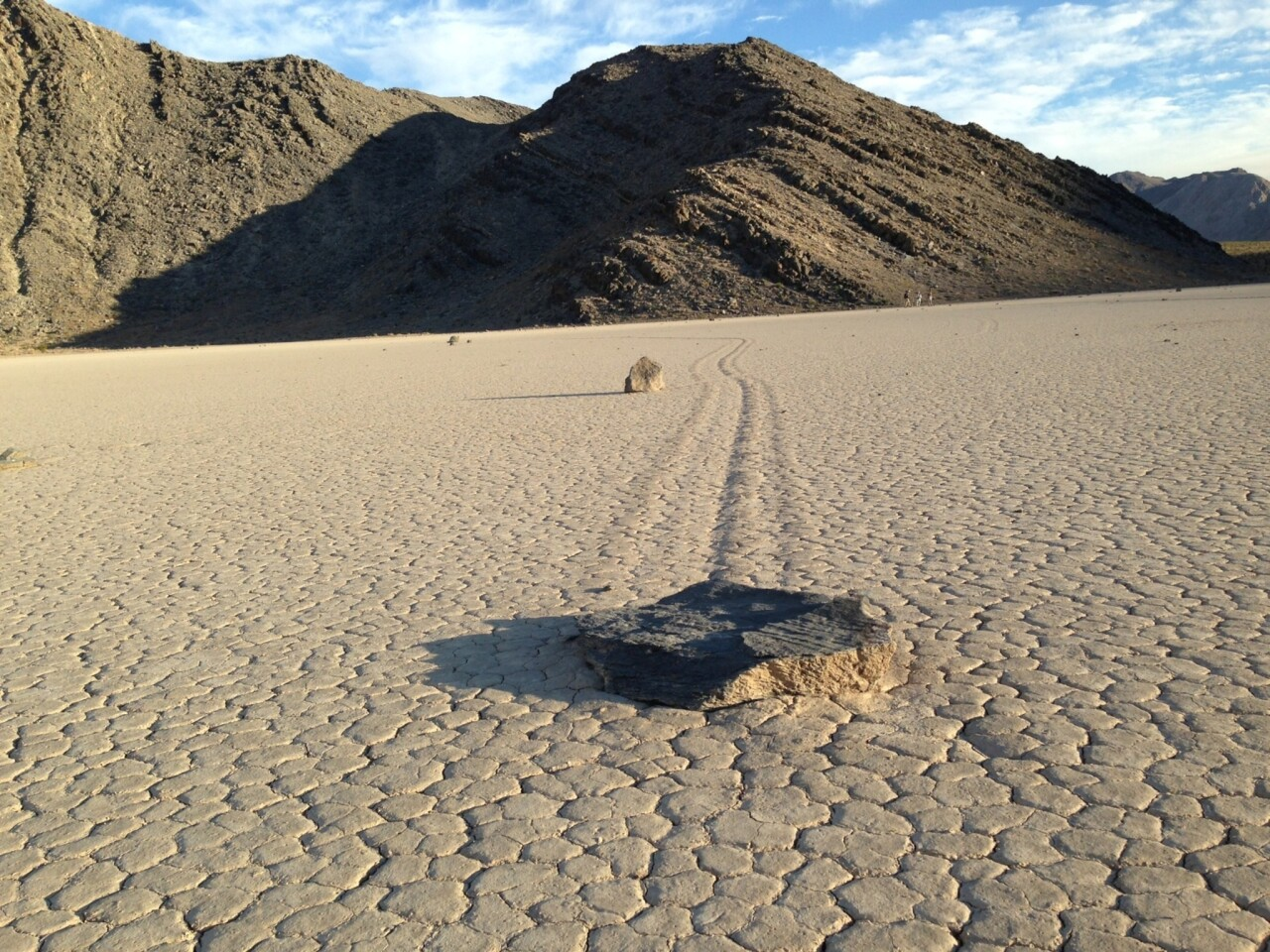 Newly published findings resolve the mystery of the moving rocks like this one that have left trails on the Racetrack playa in Death Valley National Park.