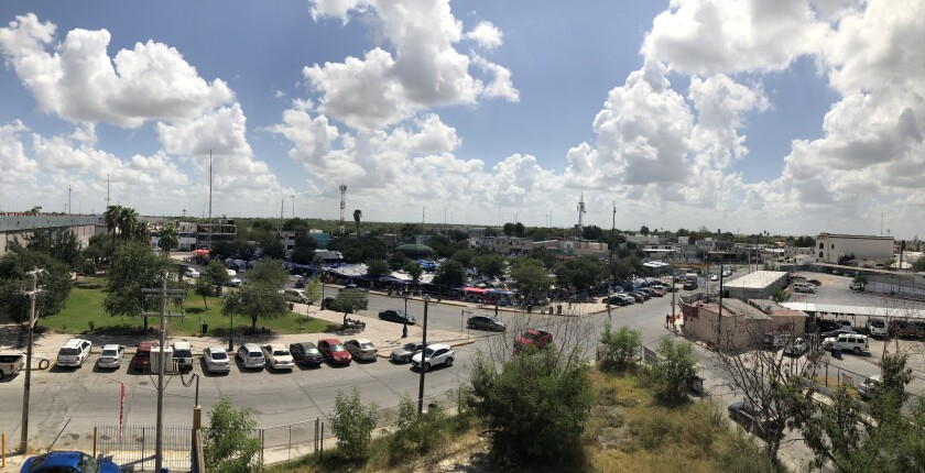 An elevated view from a distance of the Plaza Las Americas migrant camp in Reynosa, Mexico