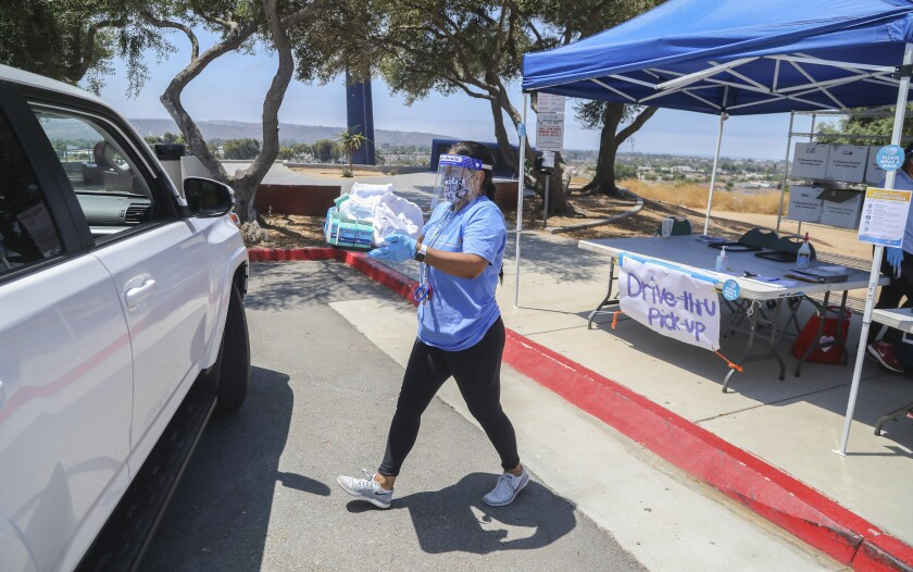 Erika Meza, a recreation leader at Montgomery Waller Community park, delivers free lunches on July 21.