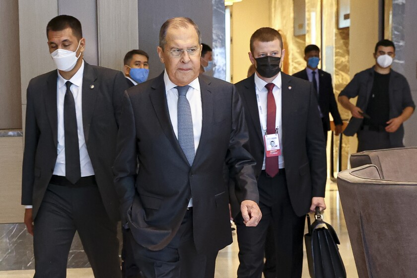 In this photo released by Russian Foreign Ministry Press Service, Russian Foreign Minister Sergey Lavrov, center, arrives to attend a Central and South Asia 2021 conference in Tashkent, Uzbekistan, Friday, July 16, 2021. (Russian Foreign Ministry Press Service via AP)