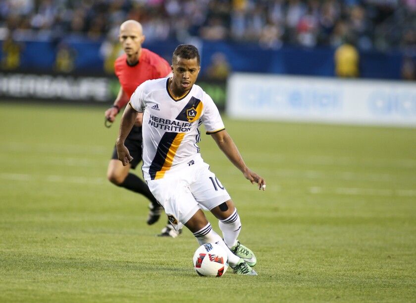 Galaxy forward Giovani dos Santos moves the ball against the Portland Timbers during an April game at StubHub Center.