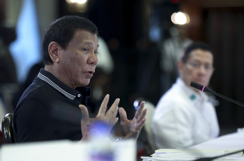 In this handout photo provided by the Malacanang Presidential Photographers Division, Philippine President Rodrigo Duterte gestures as he speaks during an Inter-Agency Task Force for the Management of Emerging Infectious Diseases at the Malacanang presidential palace in Manila, Philippines on Monday March 16, 2020. Duterte addressed the nation on the new coranavirus after the meeting. For most people, the new coronavirus causes only mild or moderate symptoms. For some, it can cause more severe illness, especially in older adults and people with existing health problems. (Ace Morandante/ Malacanang Presidential Photographers Division via AP)