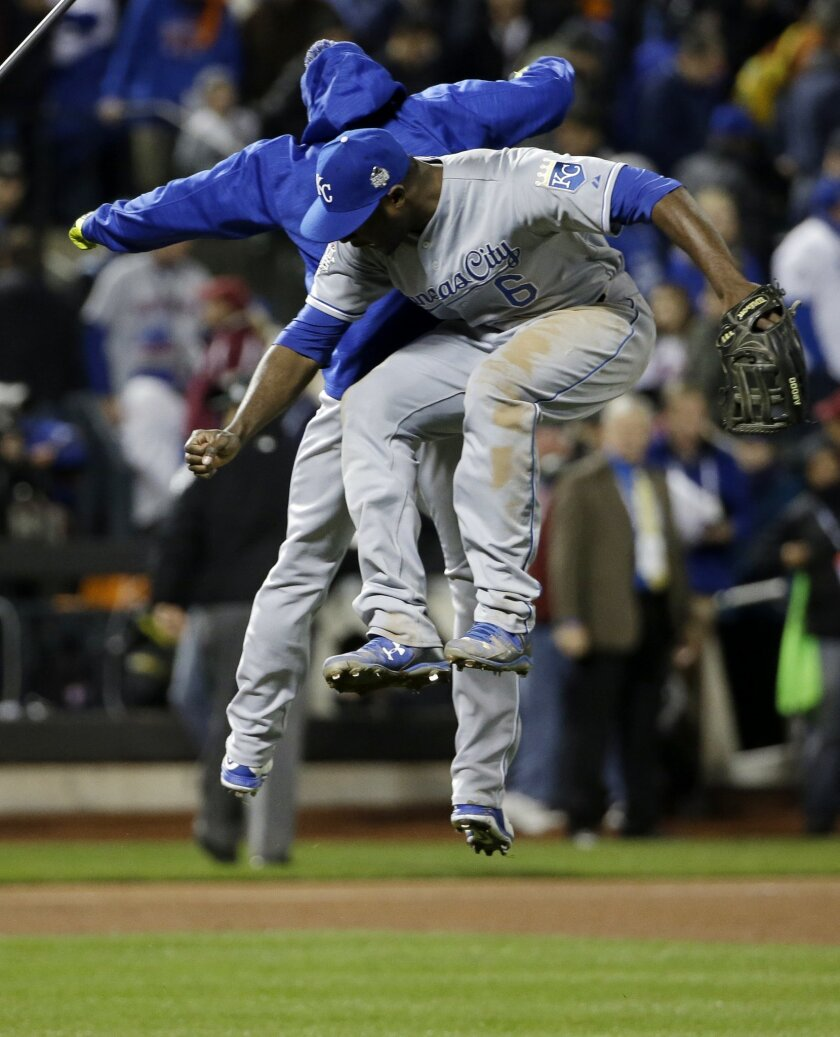 Kansas City Royals' Lorenzo Cain celebrates with a teammate after Game 4 of the Major League Baseball World Series against the New York Mets Saturday, Oct. 31, 2015, in New York. The Royals won 5-3 to take a 3-1 lead in the series. (AP Photo/David J. Phillip)