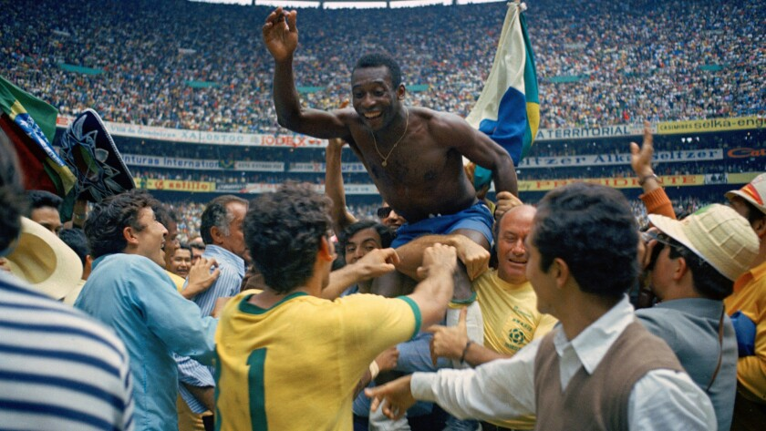 Pelé is lifted in celebration after Brazil's win over Italy in the 1970 World Cup final.