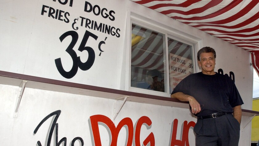 Dick Portillo is photographed in 2004 near a replica of The Dog House trailer where he started selling hot dogs in 1963.