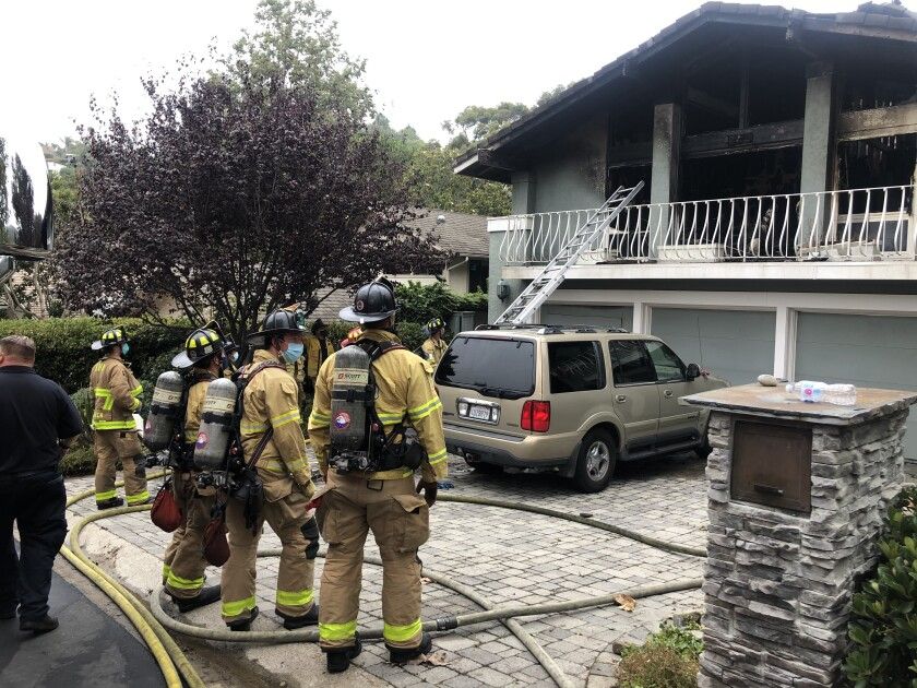 The bodies of two people were discovered inside a La Jolla home that caught fire early Monday morning.