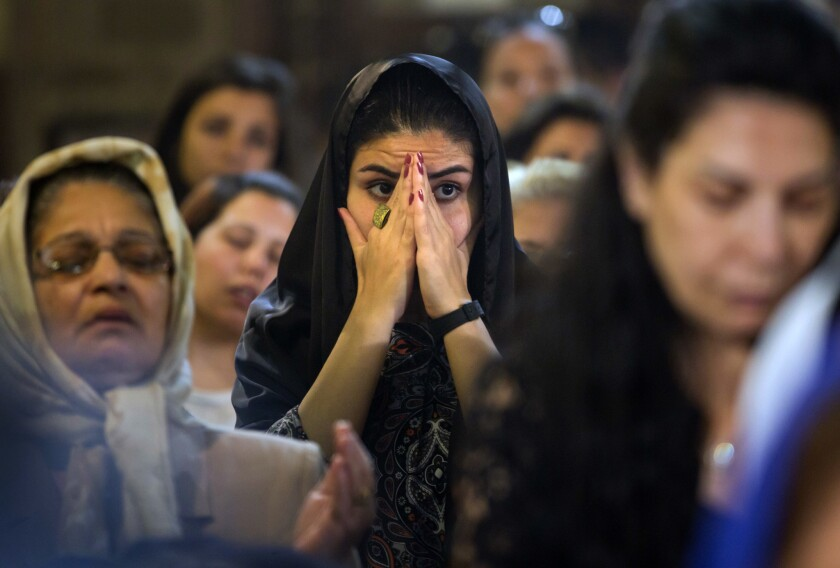 Coptic Christians attend prayers for the departed, remembering the victims of EgyptAir flight 804 at Al-Boutrossiya Church in Cairo, Egypt, on May 22, 2016.