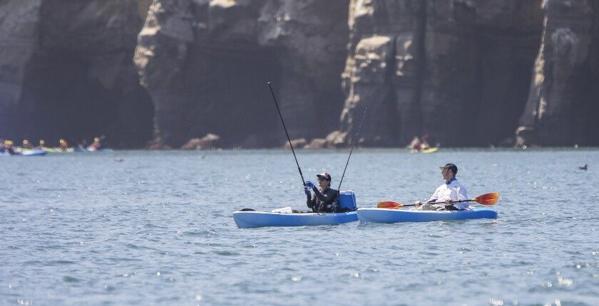 Trina Williams (left) and Russell Castiglione (right) fish off of La Jolla Cove in the Matlahuayl aarine protected area on August 9, 2019 in San Diego, California.