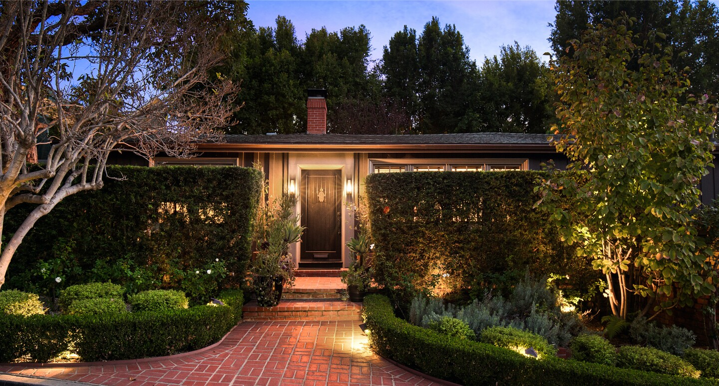 Perched in the Hollywood Dell, the two-story home has been updated over the years but has stayed in touch with its vintage charm.
