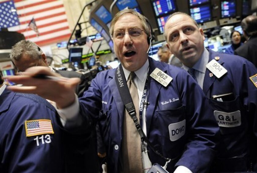 Traders Warren Meyers, left, and Michael Urkonis work on the floor of the New York Stock Exchange Wednesday, Feb. 11, 2009. (AP Photo/Richard Drew)