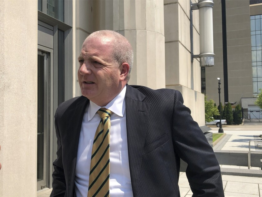 Paul T. Farrell Jr., an attorney representing plaintiffs in a lawsuit against three major U.S. drug distributors, speaks to reporters Wednesday, July 28, 2021, outside the federal courthouse in Charleston, W.Va. Attorneys finished giving closing arguments in the case brought by Cabell County and the city of Huntington accusing AmerisourceBergen, Cardinal Health and McKesson of creating a public nuisance by distributing 81 million pills over eight years. (AP Photo/John Raby)