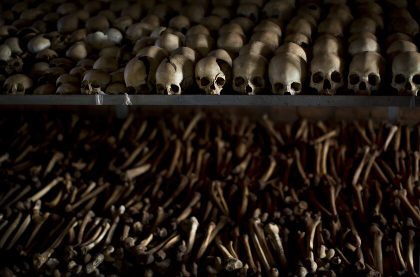 FILE - In this Friday, April 4, 2014 file photo, the skulls and bones of some of those who were slaughtered as they sought refuge inside the church are laid out as a memorial to the thousands who were killed in and around the Catholic church during the 1994 genocide in Ntarama, Rwanda. France's highest court on Wednesday Sept.30, 2020 rejected Rwandan genocide suspect Félicien Kabuga's appeal of a decision to extradite him to an international court in The Hague. Kabuga, one of the most-wanted fugitives in Rwanda's 1994 genocide, was arrested outside Paris in May after 25 years on the run. (AP Photo/Ben Curtis, File)