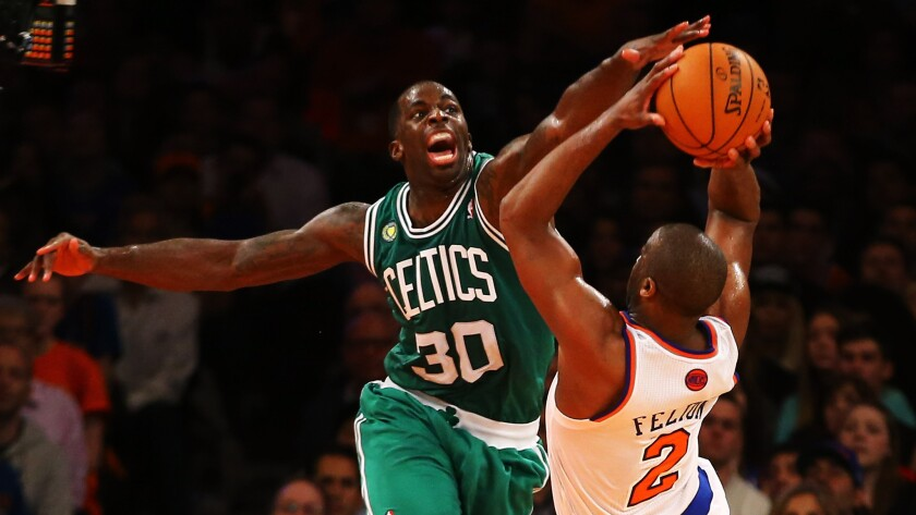 Boston Celtics power forward Brandon Bass, left, tries to block a shot by New York Knicks point guard Raymond Felton during a playoff game in May 2013.