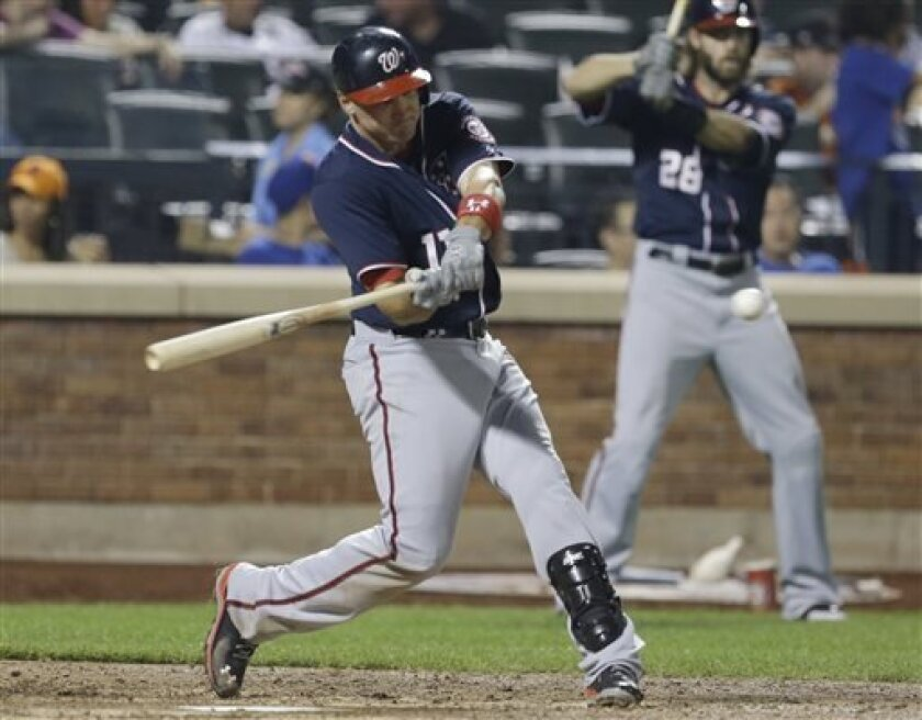 Washington Nationals' Ryan Zimmerman hits a home run during the sixth inning of a baseball game against the New York Mets, Wednesday, Sept. 11, 2013, in New York. (AP Photo/Frank Franklin II)