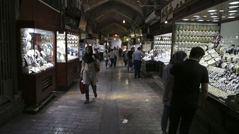 In this Sunday, Aug. 12, 2018 photo, people visit a gold market at the Grand Bazaar in Tehran, Iran.