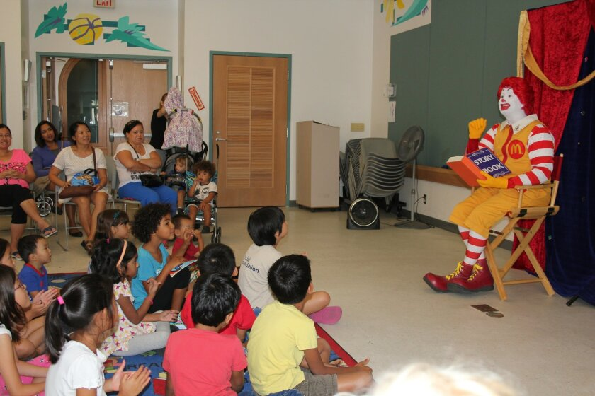 Ronald McDonald's recent appearance at the Carmel Valley Library included magic and puppetry. Photo by Karen Billing